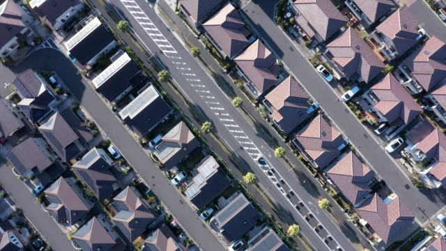 aerial view of detached houses in suburb - inquadratura da un aereo video stock e b–roll