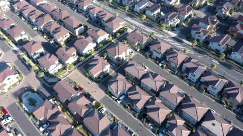 aerial view of detached houses in suburb - aircraft point of view stock videos & royalty-free footage