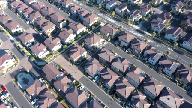 vídeos y material grabado en eventos de stock de aerial view of detached houses in suburb - perspectiva desde un avión