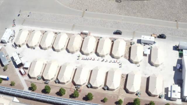 aerial view of detention tents holding children at the us border in el paso - emigration and immigration stock videos & royalty-free footage