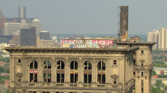 Aerial view of Detroit's abandoned Michigan Central Station, a deserted train depot, now in severe disrepair and marked with graffiti.