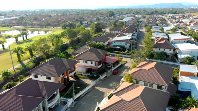 aerial view of development housing in chiang mai-thailand. - townhouse stock videos & royalty-free footage