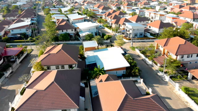 aerial view of  development housing in chiang mai-thailand. - tilt up stock videos & royalty-free footage