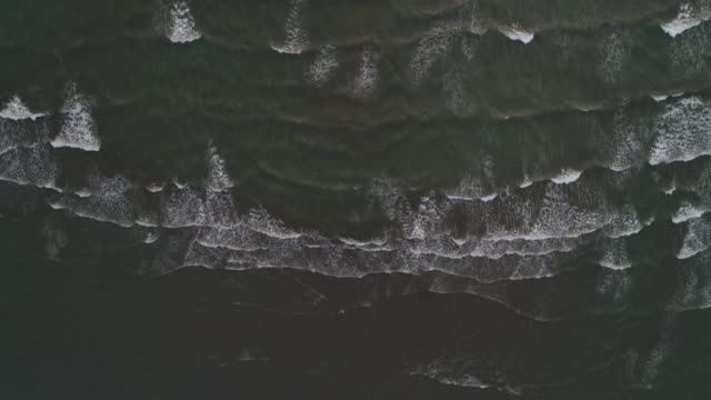 aerial view of dirty beach and ocean with waves - imperfection stock videos & royalty-free footage