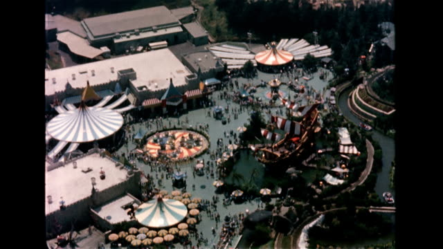 / aerial view of disneyland showing rides, attractions, scope of park. aerial of disneyland on january 01, 1956 in anaheim, california - anaheim california stock videos & royalty-free footage