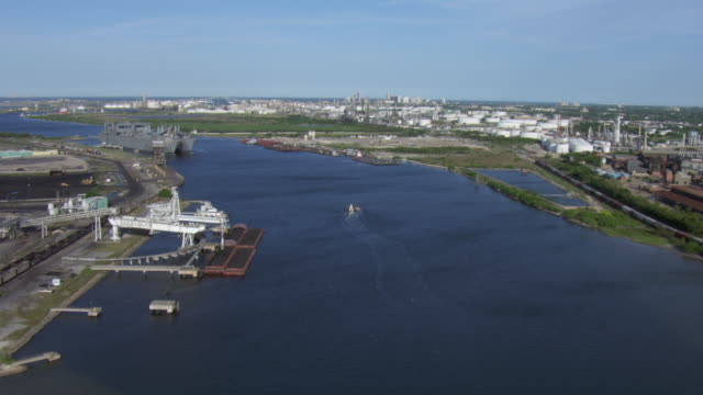 aerial view of docks and barges in corpus christi port with oil and gas industrial plant, corpus christi, texas. - corpus christi texas stock videos & royalty-free footage