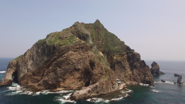 aerial view of dokdo island (natural monument heritage and one of most famous island in korea) - north gyeongsang province stock videos and b-roll footage