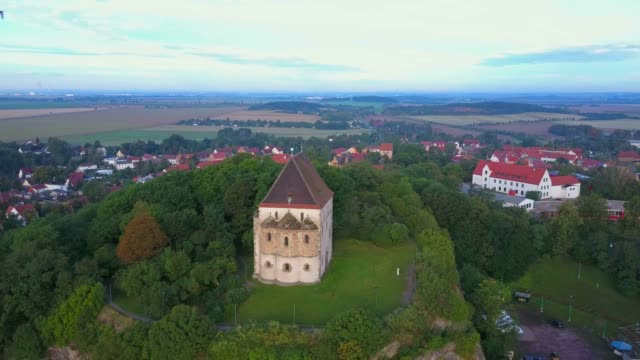 vídeos de stock e filmes b-roll de aerial view of double chapel st. cruis in landsberg, saalekreis, near haale, saxony-anhalt, germany - circa 13th century