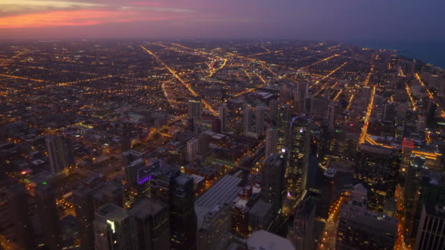 Aerial view of downtown Chicago city skyline at night in Illinois