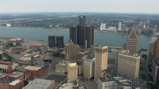 Aerial view of downtown Detroit, and across the river, Windsor, Ontario. Together the two cities form an international metroplex populated by 5.7 million people.