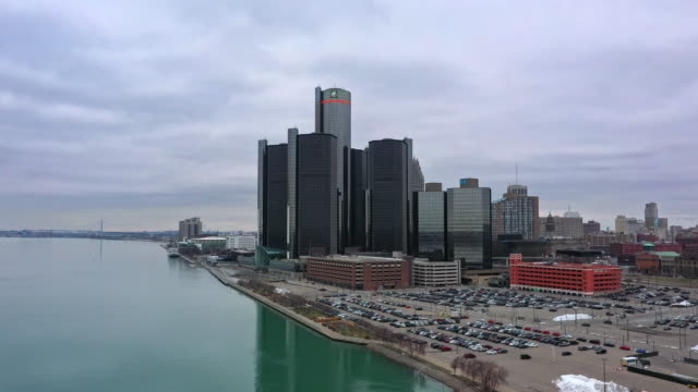 aerial view of downtown detroit from over river - detroit river stock-videos und b-roll-filmmaterial