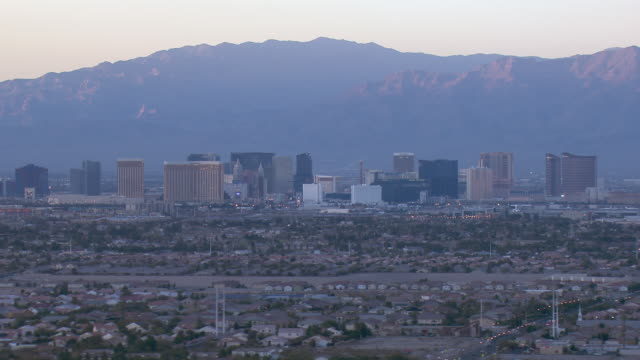 aerial view of downtown las vegas against mountains, nevada, united states of america. - the palazzo las vegas stock videos & royalty-free footage