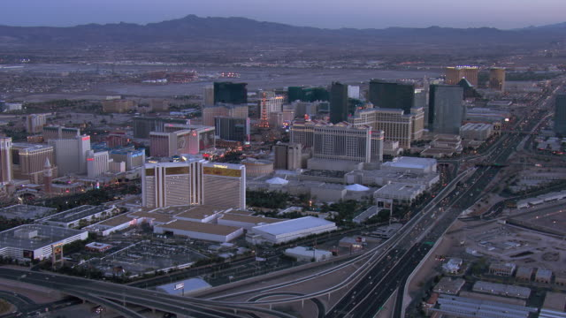 aerial view of downtown las vegas at dusk, nevada, united states of america. - the palazzo las vegas stock videos & royalty-free footage