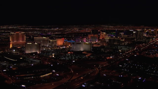 aerial view of downtown las vegas buildings at night, nevada, united states of america. - the palazzo las vegas stock videos & royalty-free footage