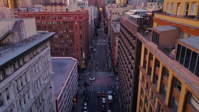 aerial view of downtown los angeles at sunset - high street stock videos & royalty-free footage