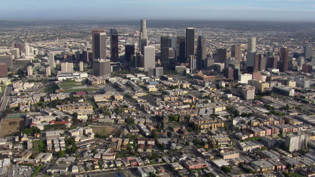 Aerial view of downtown Los Angeles, flying over the tops of skyscrapers.