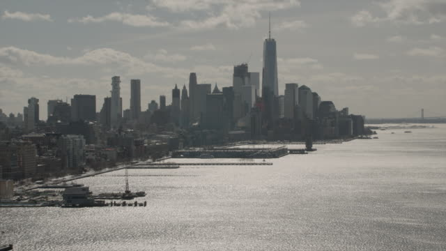 aerial view of downtown manhattan skyline facing south from the hudson river - sunny video stock e b–roll