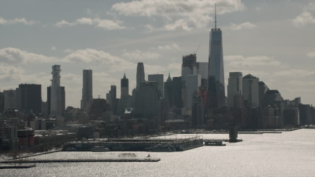 Aerial View Of Downtown Manhattan Zooming Into Buildings On A Sunny Winter Day