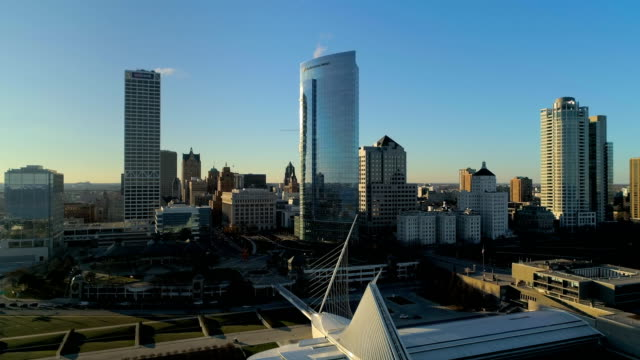 aerial view of downtown milwaukee skyline at sunset in wisconsin - lake michigan stock videos & royalty-free footage
