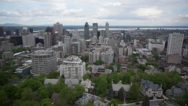aerial view of downtown montreal and mount royal park - montreal video stock e b–roll