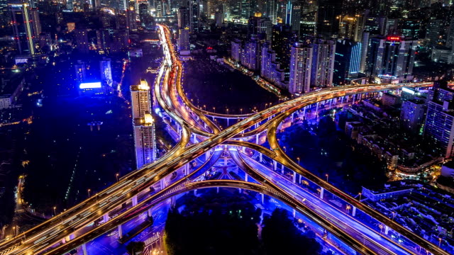 t/l ms ha aerial view of downtown shanghai at night / shanghai, china - traffic time lapse stock videos & royalty-free footage