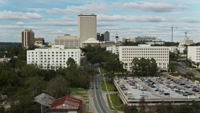aerial view of downtown tallahassee from a strip mall to the florida state capitol - florida us state stock videos & royalty-free footage