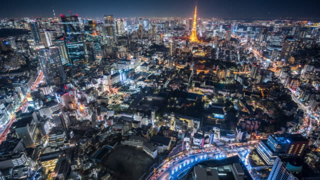 t/l ws ha aerial view of downtown tokyo at night / tokyo, japan - japan stock-videos und b-roll-filmmaterial