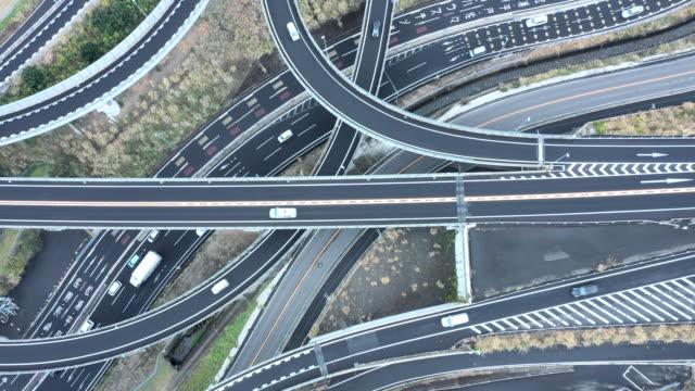 aerial view of driving highway in suburb - 高速道路点の映像素材/bロール