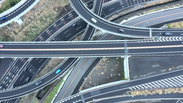 aerial view of driving highway in suburb - motorway stock videos & royalty-free footage