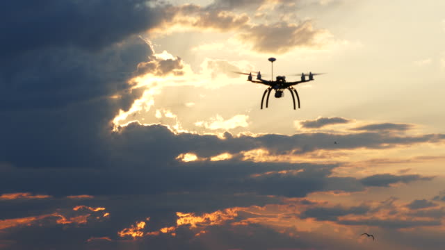 4k aerial view of drone flying in sky - radio controlled handset stock videos and b-roll footage