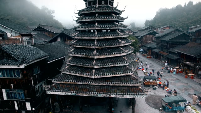 aerial view of drum tower in zhaoxing dong village at morning, guizhou, china - pagoda stock videos & royalty-free footage