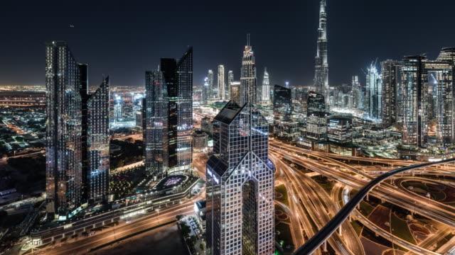 t/l pan aerial view of dubai skyline at night / dubai, uae - middle east stock videos & royalty-free footage