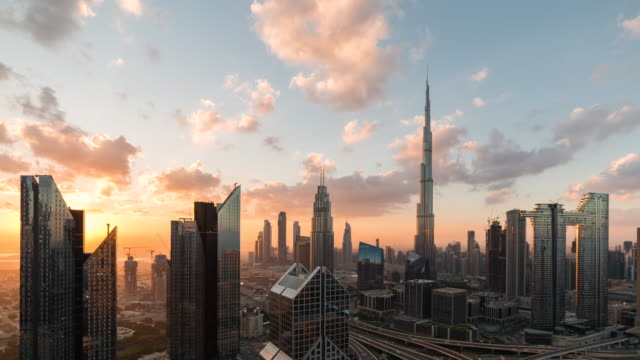 t/l aerial view of dubai skyline at sunrise / dubai, uae - skyline stock videos & royalty-free footage