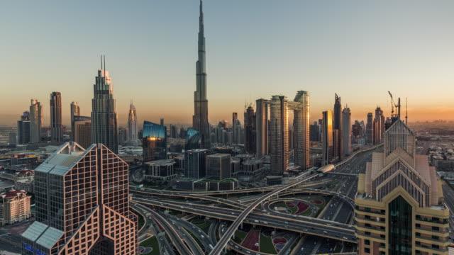 t/l tu aerial view of dubai skyline at sunset / dubai, uae - burj khalifa stock videos & royalty-free footage