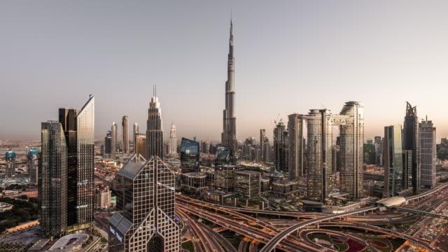 t/l aerial view of dubai skyline, day to night transition - burj khalifa stock videos & royalty-free footage