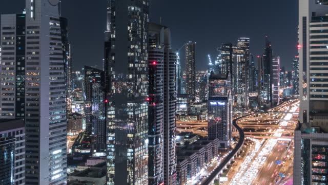 t/l pan aerial view of dubai skyline, dusk to night transition / dubai, uae - financial district stock videos & royalty-free footage