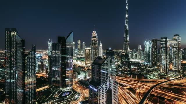 t/l td aerial view of dubai skyline, dusk to night transition / dubai, uae - sequential series stock videos & royalty-free footage