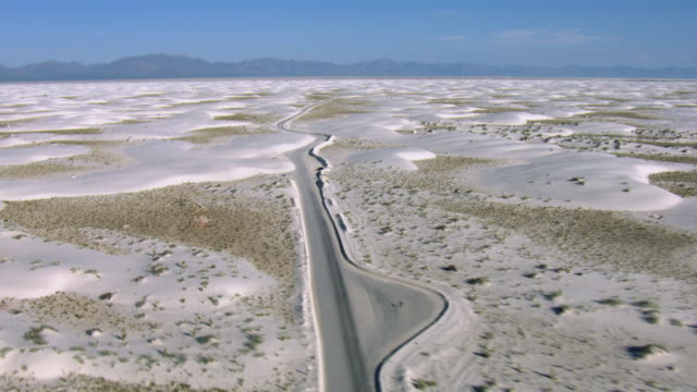 aerial view of dunes drive in white sands national monument passing through chihuahuan desert in new mexico, united states of america - new mexico stock videos & royalty-free footage