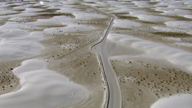 aerial view of dunes drive passing through white sands national park in new mexico, united states of america - new mexico stock videos & royalty-free footage