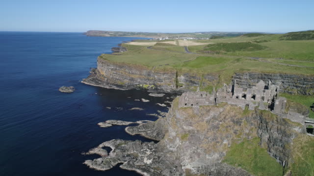 aerial view of dunluce castle ruin on green antrim coastline, ireland - atlantic islands stock videos & royalty-free footage