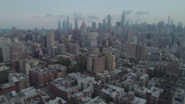 aerial view of east village new york city facing uptown looking towards the new york city skyline. usa. - manhattan stock videos & royalty-free footage