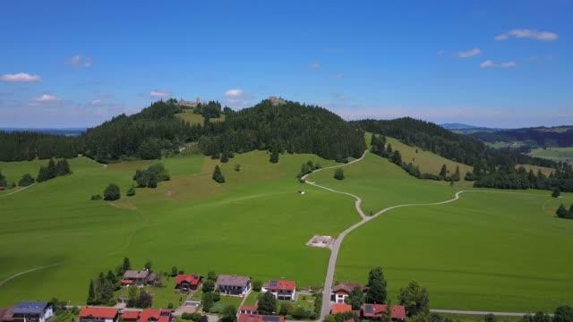 aerial view of eisenberg and castle ruins, allgau alps, allgau, swabia, bavaria, germany, europe - idylle stock-videos und b-roll-filmmaterial