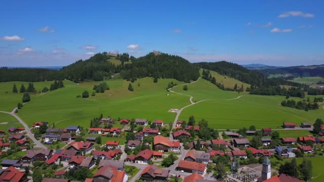 stockvideo's en b-roll-footage met aerial view of eisenberg and castle ruins, allgau alps, allgau, swabia, bavaria, germany, europe - bavarian alps