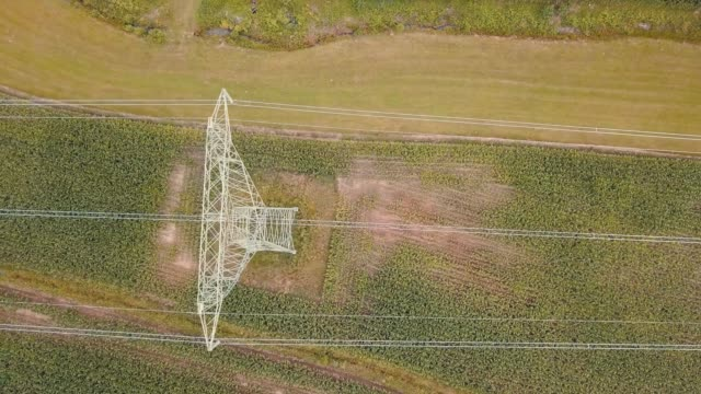 aerial view of electrical wires large scale power energy tower - transformer stock videos & royalty-free footage