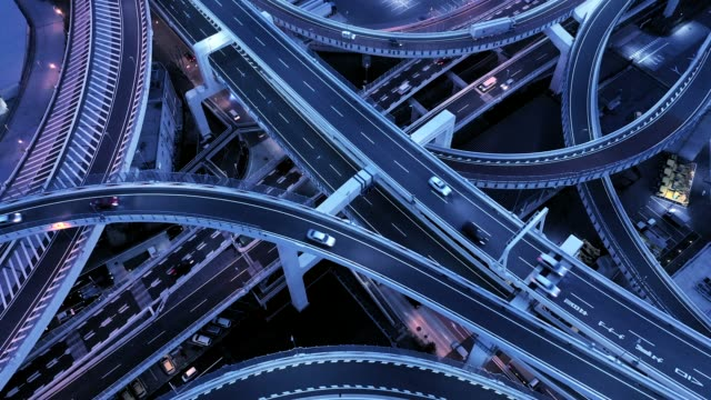 aerial view of elevated highway at night - road sign stock videos & royalty-free footage