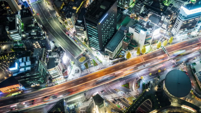 t/l ms ha zi aerial view of elevated roads at night / tokyo, japan - バイパス点の映像素材/bロール