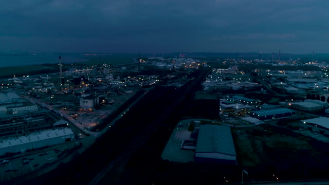 aerial view of ellesmere port industrial area at night river mersey and stanlow - cheshire england stock videos & royalty-free footage