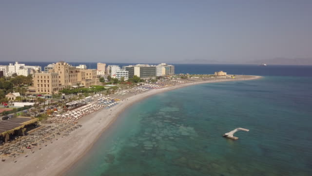 aerial view of elli beach in rhodes greece elli beach is the closest beach to rhodes town located between the area of mandraki the rhodes aquarium it... - insel rhodos inselgruppe dodekanes stock-videos und b-roll-filmmaterial