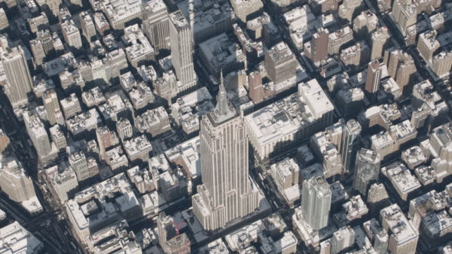 aerial view of empire state building on a sunny winter day - empire state building video stock e b–roll