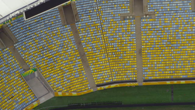 aerial view of empty pitch, seats of football arena - sport venue stock videos & royalty-free footage